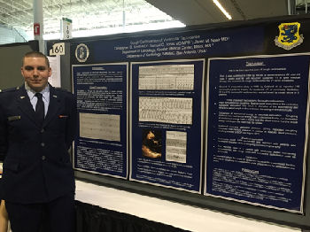 Capt Christopher Smith giving a poster presentation on cough cardio- Version of VT.